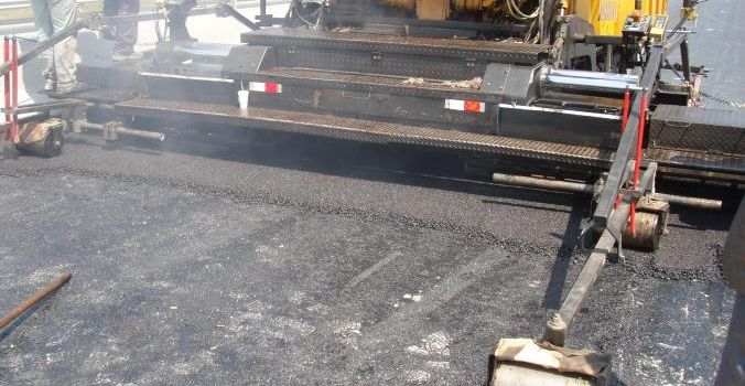 Asphalting the motorway P.A.THE